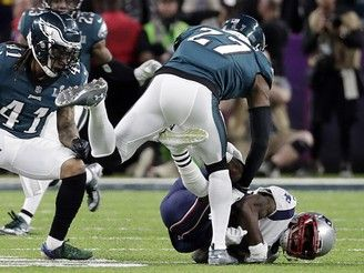 New England Patriots wide receiver Brandin Cooks (14), falls after colliding with Philadelphia Eagles strong safety Malcolm Jenkins (27), during the first half of the NFL Super Bowl 52 football game, Sunday, Feb. 4, 2018, in Minneapolis. To the left is Philadelphia Eagles cornerback Ronald Darby (41). (AP Photo/Tony Gutierrez)