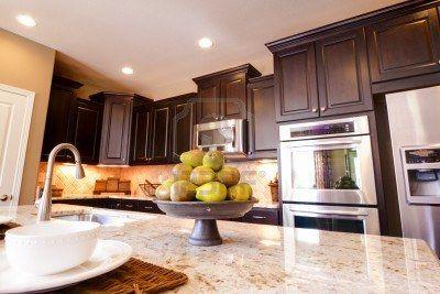 contemporary dark wood kitchen cabinets Modern Kitchen With Dark Wood Cabinets And Hardwood Floors