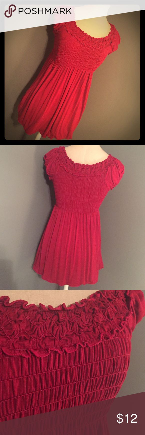 Max Studio red smocked top This red smocked Max Studio is perfect for the upcoming Holiday season!  It is a cranberry red, not a tacky bright Holiday red. The smocking detail is beautiful and makes the bust area very comfortable and have a nice feminine fit. Worn a few times and no flaws. Very soft and stretchy! Max Studio Tops Tees - Short Sleeve