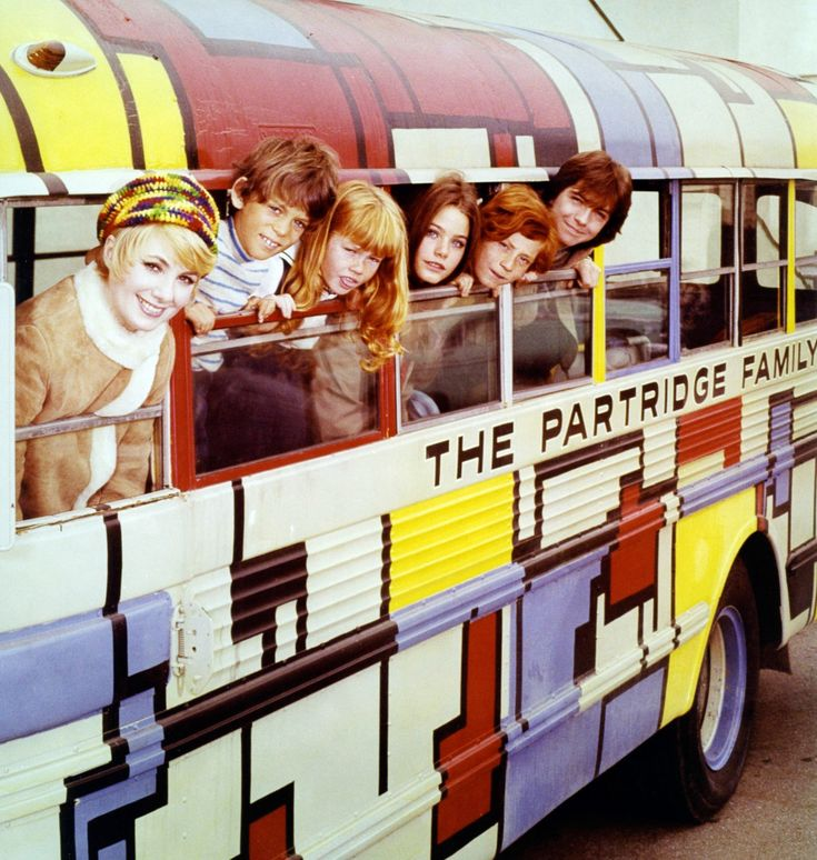 David Cassidy – a life in pictures (left leaning out of Mondrian-inspired skoolie  in a portrait issued for the US television series The Partridge Family, 1973; heartthrob to Yankee Gran's 12-yr old self!) | with Shirley Jones, Brian Forster, Suzanne Crough, Susan Dey, Danny Bonaduce,  | image: Silver Screen Collection/Getty Images