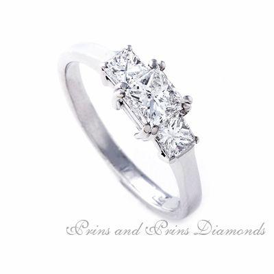 Centre diamond is a 0. 70ct J – K/SI 1 – SI2 Princess cut diamond with 2 = 0.56ct princess cut side diamonds set in 18k white gold
