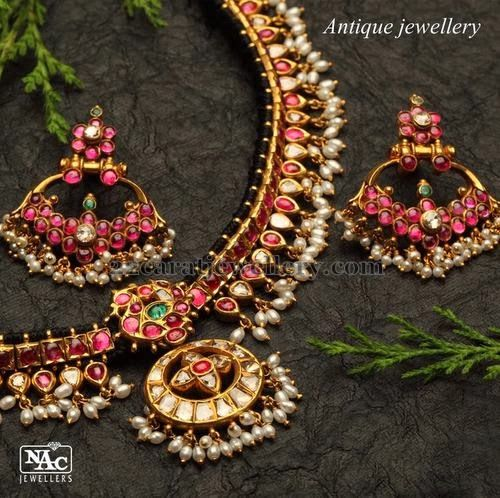 Pearl drop necklace with rubies and chand bali earrings