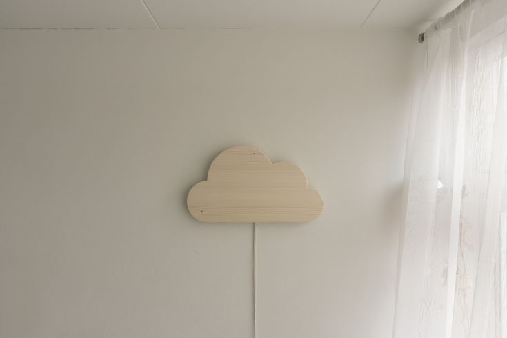 Woodwork. A cute cloud shaped lamp I made for my baby son. This handmade night light is made from pine wood and an LED-strip on the back makes the cloud glow in any colour of the rainbow.