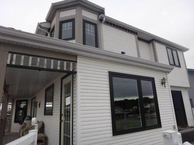 Vinyl windows black exterior window frame black capping white interior homestars simply for Best way to restore exterior black plastic trim