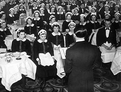 LONDON, MARCH 4, 1939 -- Waitresses, known as nippies, at Lyon's Corner House receive their instructions at the start of the day.