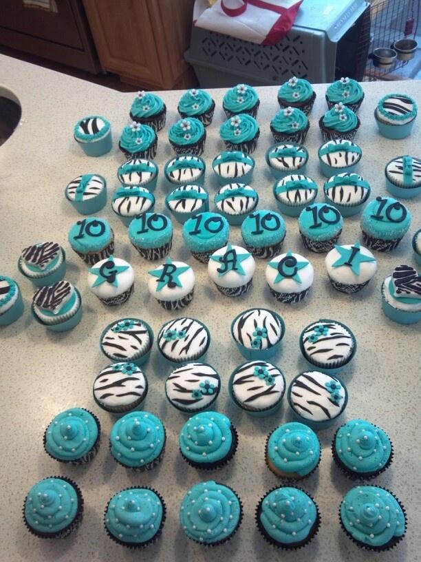 Teal and zebra print cupcakes