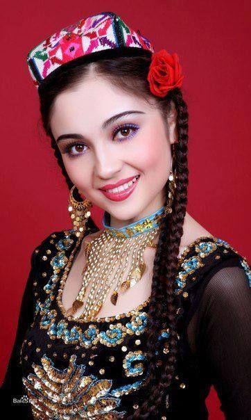 Uyghur woman in traditional dress. www.SELLaBIZ.gr ΠΩΛΗΣΕΙΣ ΕΠΙΧΕΙΡΗΣΕΩΝ ΔΩΡΕΑΝ ΑΓΓΕΛΙΕΣ ΠΩΛΗΣΗΣ ΕΠΙΧΕΙΡΗΣΗΣ BUSINESS FOR SALE FREE OF CHARGE PUBLICATION