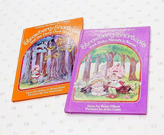 """A pair of vintage Strawberry Shortcake hardcover story books for kids. """"Strawberry Shortcake and the Deep Dark Woods"""", and """"Strawberry Shortcake and Baby Needs a Name"""". Made in 1984 by Parker Bros., American Greetings Corp. Both are in fine condition with just minor surface wear."""