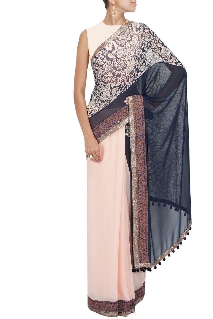 Peach and navy blue printed pallu sari with blue raw silk blouse piece BY MANISH MALHOTRA Shop the designer now at: www.perniaspopups... #perniaspopupshop #manishmalhotra #newcollection #softhues #stunning #fashion #amazing #style #campaign #fabulous #musthave #summerwedding #happyshopping