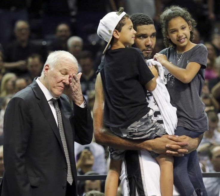 San Antonio Spurs Tim Duncan holds his children Draven (left) and Sydney as. In 1996, Gregg Popovich ...