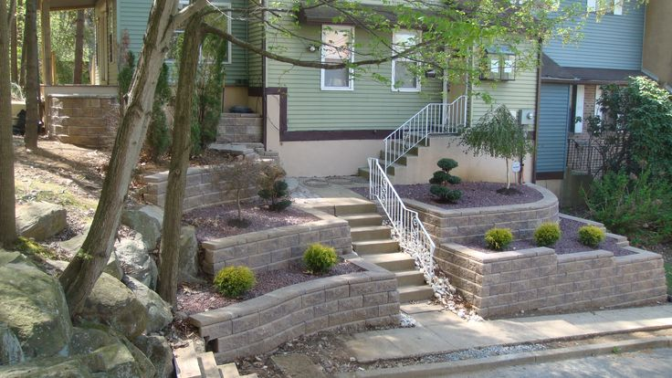 17 best ideas about backyard retaining walls on pinterest for Sloped yard solutions