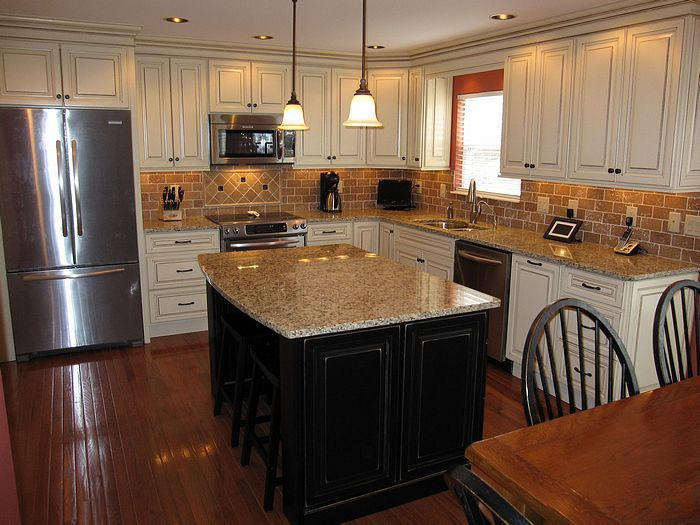 Cream Kitchen Cabinets With Black Island Oak Hardwood Flooring And