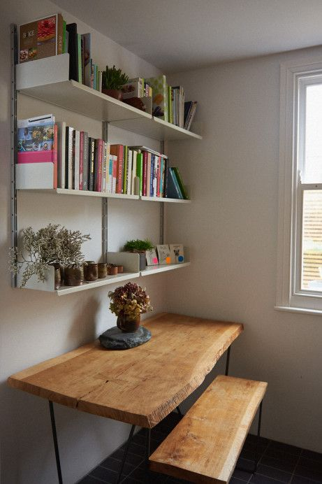 Freunde von freunden. Natural edge table and bookshelves.  Though I prefer a gallery wall.  For stylish, tiny living.