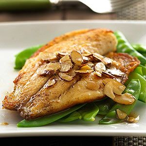 Tilapia with Almond Butter For a main dish in less than 30 minutes, try this white fish served over cooked pea pods with a topping of toasted almonds.