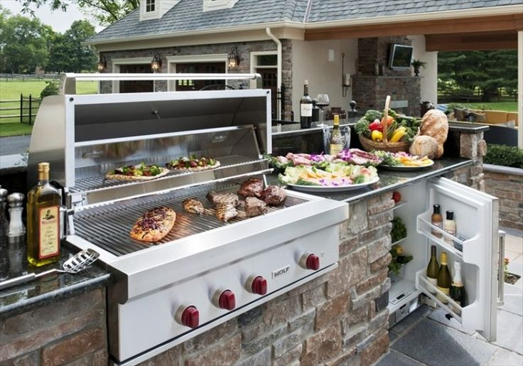 cuisine extérieure avec un frigo dans votre espace terrasse