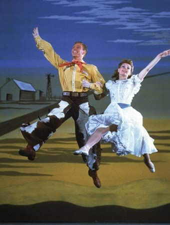 Photograph:The original production of the musical Oklahoma! opened on Broadway in 1943. Oklahoma! was notable for its seamless blending of song, dance, and plot.