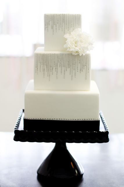 silver decorated wedding cake. Square tiers just make it that little bit different!