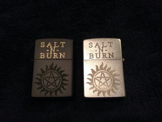 This is a custom laser engraved Zippo lighter. The zippo lighter is what is most commonly used to salt and burn demons and bones on the show. It is