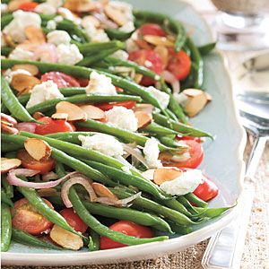 83 Spectacular Thanksgiving Sides | Green Beans with Goat Cheese, Tomatoes, and Almonds | SouthernLiving.com