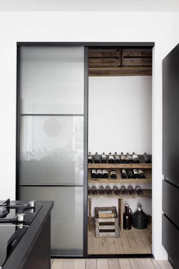 Wine storage room in Kitchen. A SCANDINAVIAN HOME IN AARHUS, DENMARK | THE STYLE FILES