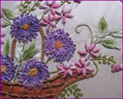 This is another Brazilian style dimensional embroidery. I have used cast on stitches for the small flowers and wrapped with daisy stitch. I feel it gives