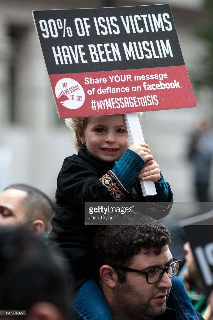 A young protester holds up a placard ahead of the annual Ashura march in Marble Arch on October 1, 2017 in London, England. Thousands of protesters march through London today to mark Ashura and celebrate the defeat of the Islamic State in Iraq and Syria. Ashura is a Muslim festival of remembrance that falls on the tenth day of Muharram in the Islamic calendar. (Photo by Jack Taylor/Getty Images)