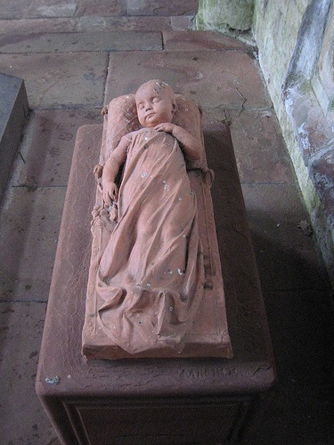Lanercost Priory - memorial to Elizabeth Dacre Howard -  died in 1883, aged four months. The exceptionally delicate terracotta memorial is by Sir Edgar Boehm.
