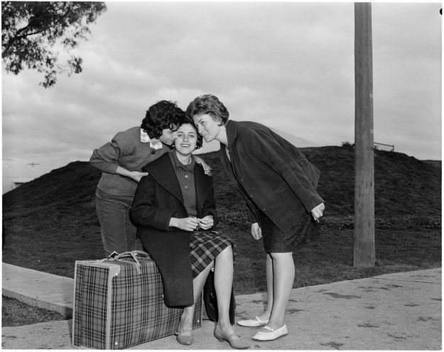 A Greek woman receives a farewell kiss from her friends before leaving Maribyrnong, Victoria, 1962.