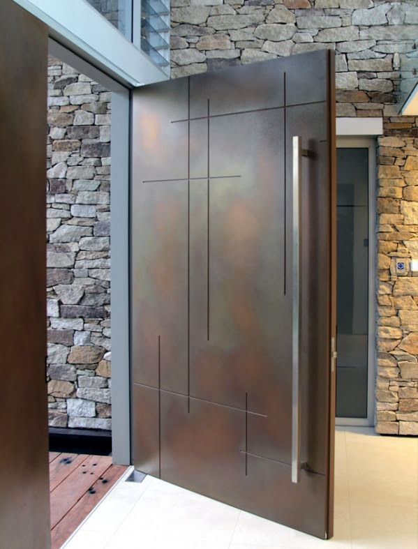 Katnich Building & Design Metal Front Door....great entrance piece.