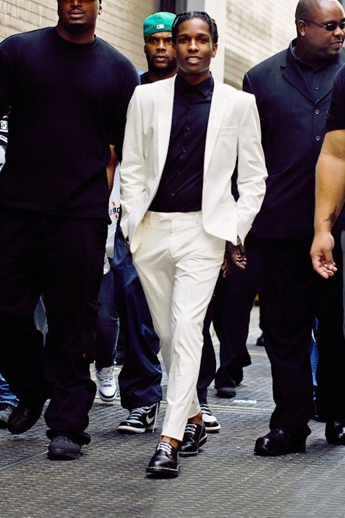 white suit with black turtleneck - would casualize it with trainers