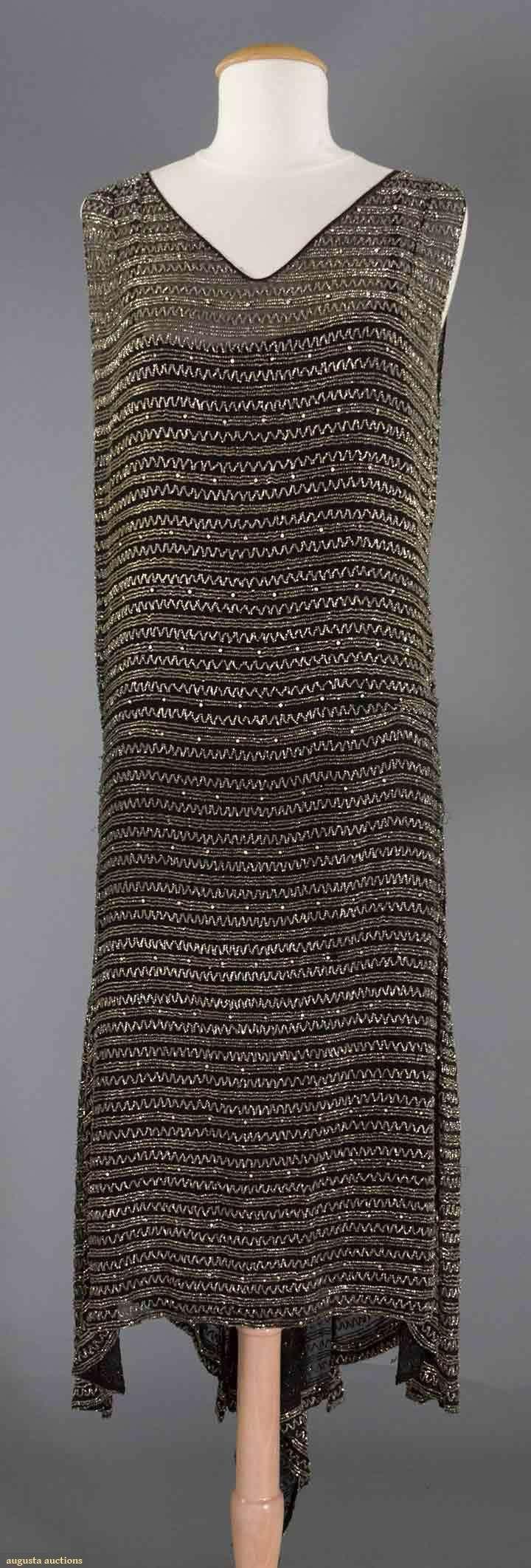 CRYSTAL BEADED SILK DRESS, c. 1928  Black chiffon over satin lining, crystal beaded narrow horizontal rows, back hem longe