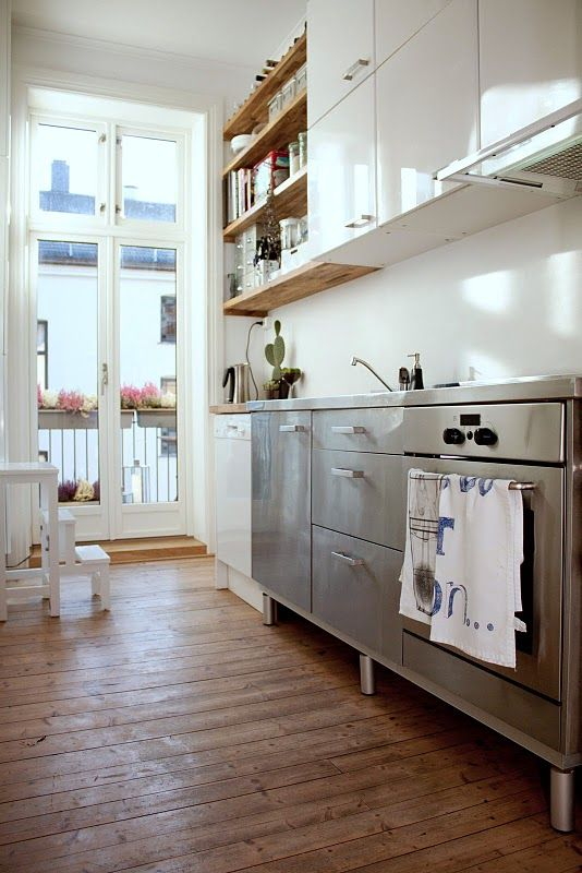 stainless steel and white kitchen with wood floors and lovely light. #kitchen #white