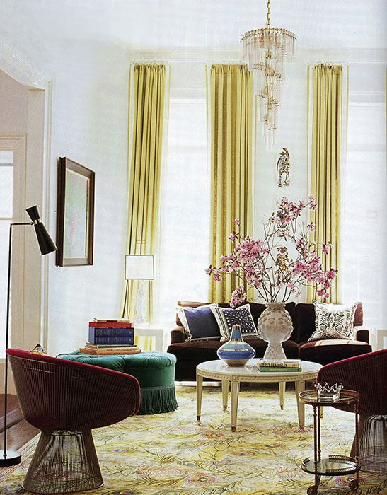 Great Elegant Curtains Drape The Floor To Ceiling Windows In The Living Room  Where The Coffee Table Is A Jonathan Adler Design And The Pair Of Circular  Armchairs ...