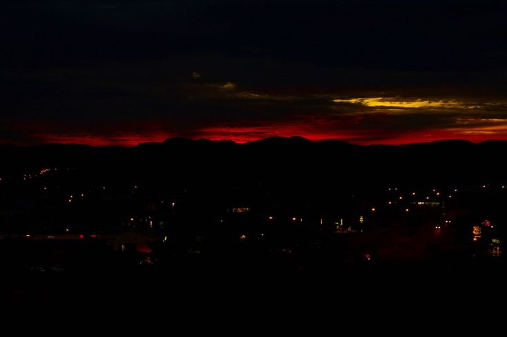 Unfiltered blood red sky during sunset at Anzac Hill Lookout in Alice Springs