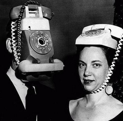 .Looks familiar except that cell phones now days fit in your hand and not your head!