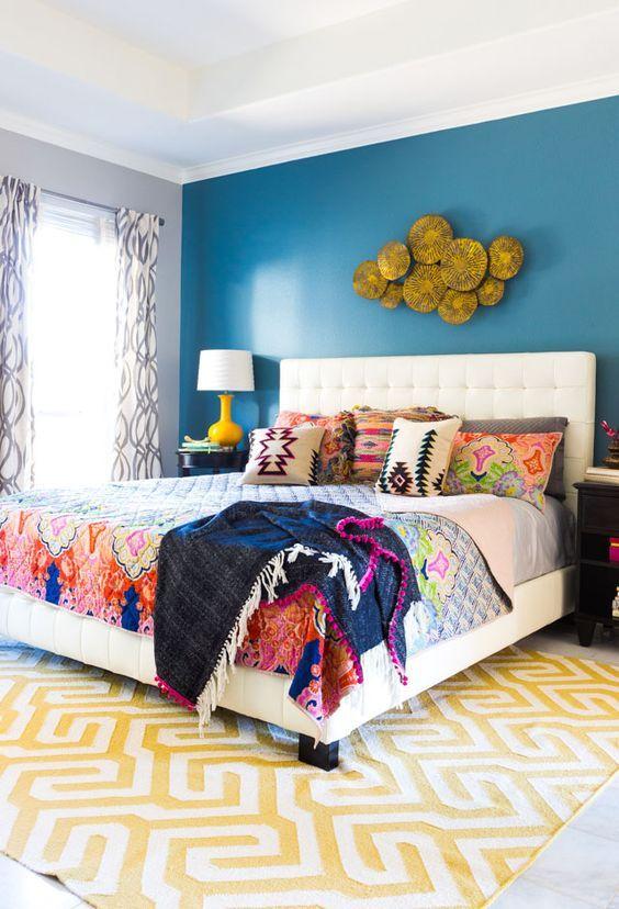 Beautiful golden wall fixture on this boho bedroom     www.bocadolobo.com #bedroomdecorideas #bedroomdecor #masterbedroom #masterbedroomideas #minimalistbedroom #luxurybedroom #dreambedroom