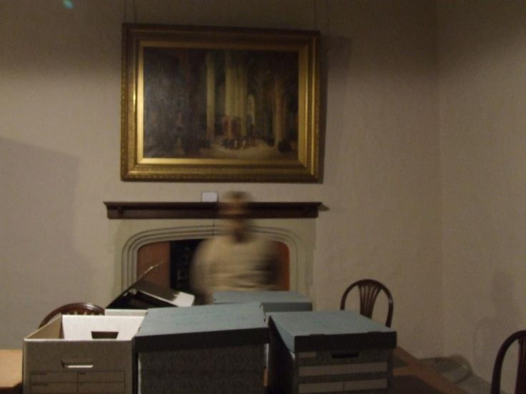 Taken at 03:08 May 5th 2013. Three people in the room , three people behind the camera , so who is this person. Taken at The oldest Almshouse in England near Winchester. One of regular venues to investigate for paranormal activity and ghosts - thoughts please !!!