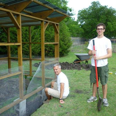 Marty and Corbin used The Garden Coop plans to build The Garden Coop larger. This shows how they buried the fencing below grade and also used concrete blocks for footings
