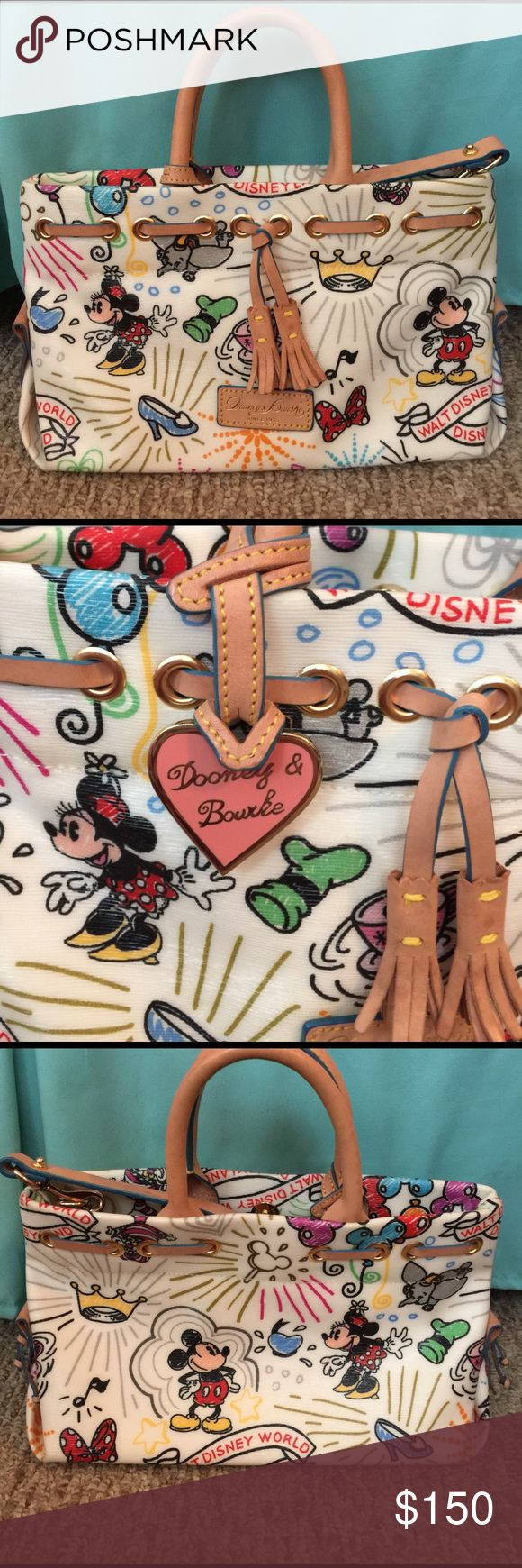 Dooney & Bourke Disney Parks Handbag/Crossbody SO CUTE! Displays Mickey and Minnie! I purchased this bag a few years ago in Disney World. Carried Twice. The only blemish I see is on the inside of the bag. Maybe a pen mark. 🤡NO TRADES🤡 please make offers within the app- will not discuss price on feed. Dooney & Bourke Bags Crossbody Bags