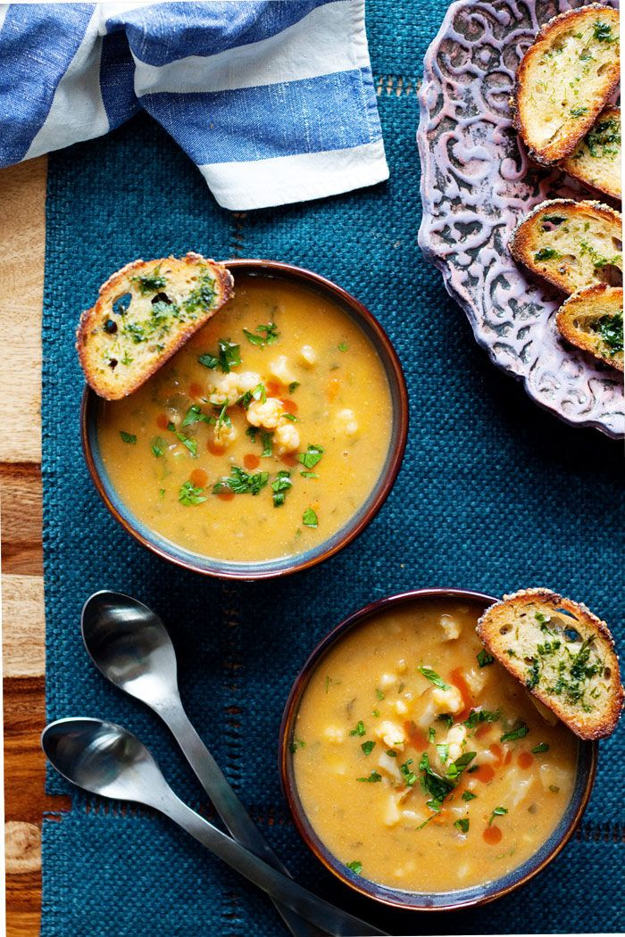 Vegan Buffalo Cauliflower Chowder with Herbed Crostini - This hearty, veggie-packed chowder recipe packs a kicky wallop, buffalo hot sauce style. Creamy, full of flavor, and, yep, vegan - though the carnivores will no doubt be clamoring for seconds, too! Don't forget the crisp broiled crostini for some delicious dipping.