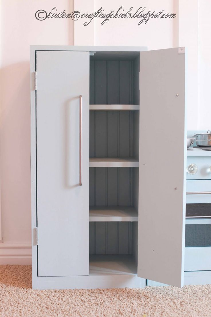 "DIY Pantry For Play Kitchen. This is a must have present for Addi because it will hold ALL of the play kitchen stuff and keep my living room looking ""organized"" :)"