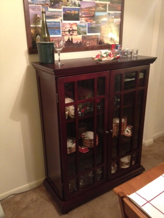 turn a nice bookshelf into a china cabinet saves tons of money and perfect for