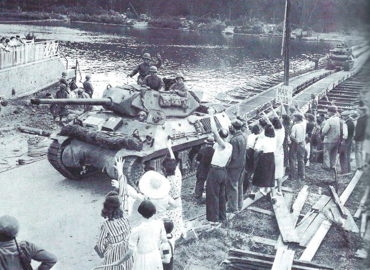 An M10 tank destroyer crosses a pontoon bridge over the the Seine on August 24, 1944