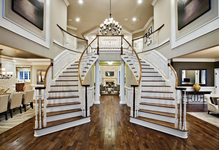 Toll Brothers - Stunning Two-Story Foyer with Double Turned Staircase in the Harding Country Manor Model Home at High Oaks Estates.
