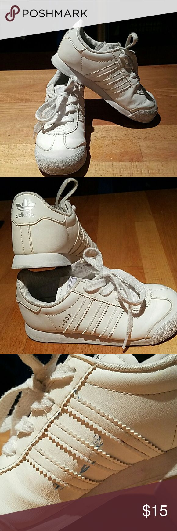 Adidas Samoa Size 10 kids unisex Adidas samoas. Silver adidas logos. Preloved condition but still have miles left to walk in! Please note the pen marks on the inside. Adidas Shoes Sneakers
