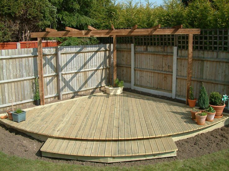pin by carie fisk on arbors and pergolas sloped garden patio flooring curved patio. Black Bedroom Furniture Sets. Home Design Ideas