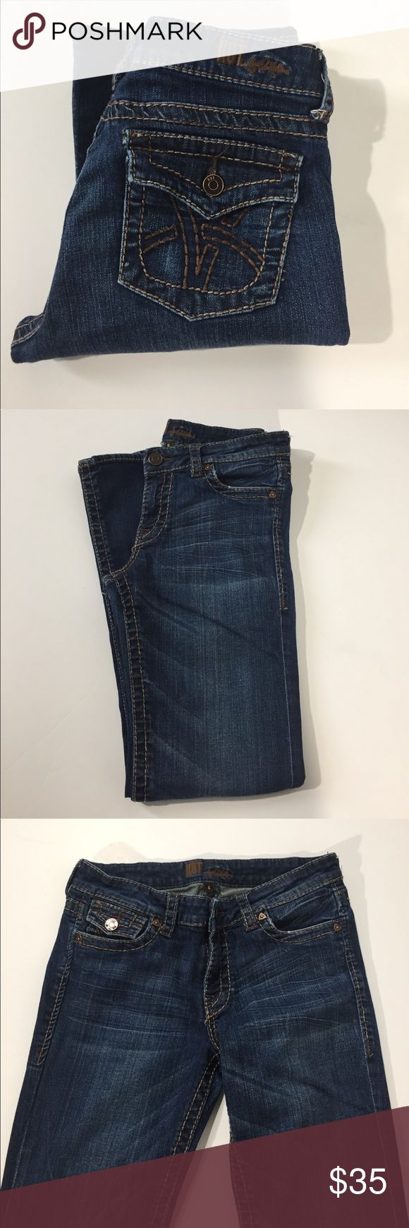 """Kut From The Kloth Low Rise Stretch Boot Cut Jeans Excellent condition. Low rise, stretch, boot cut. Back flap pockets. Flap coin pocket. Darker wash. Extremely minor distressing to hems. A few threads are starting to loosen on back pocket stitching. Factory fading. Size 6. 99% cotton, 1% spandex. Waist about 30"""", rise about 8.5"""", inseam about 31"""". Not from a smoke free house. 614 Kut from the Kloth Jeans Boot Cut"""