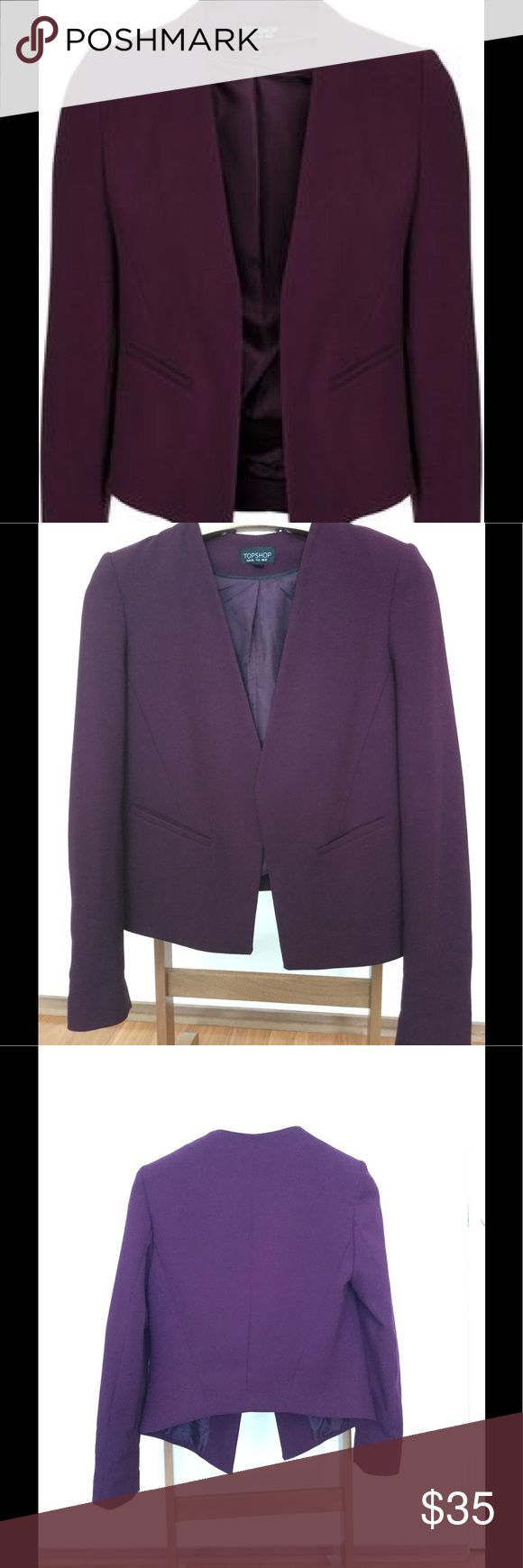 Topshop Slim Curve Blazer oxblood Slim tailored jacket with back curve detail and open front. Slight wear on lining near label (pictured). Otherwise, great condition, no other noticeable wear.  Topshop called this color oxblood, but its more purple than red. Topshop Jackets & Coats Blazers