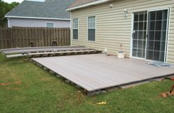 Lowdecktt15 diy steps for building a deck over a patio for Building a low profile deck