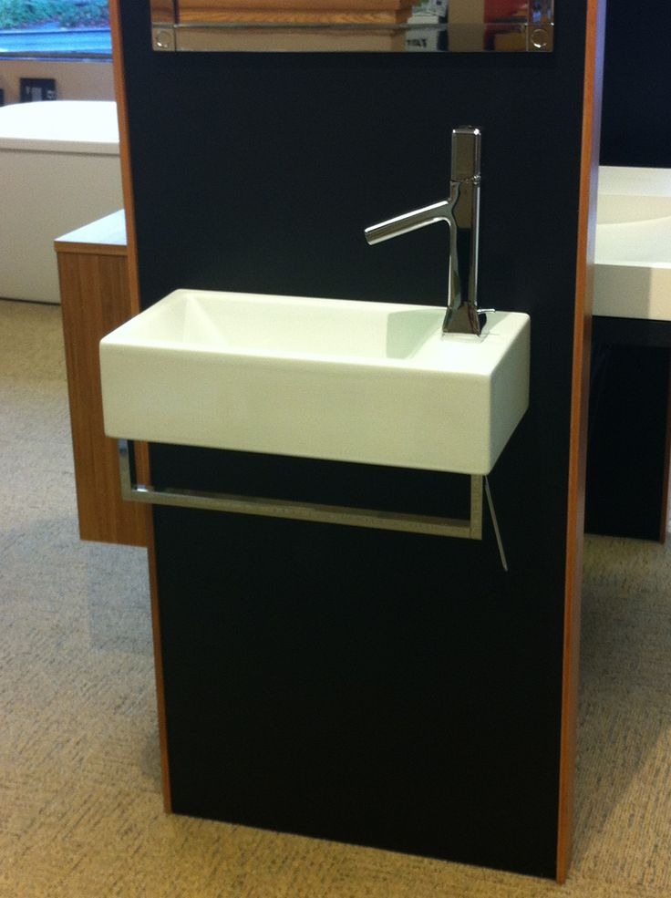 """Sink with built-in towel rail. Can also wall mount faucet. W19.69"""" x D9.84"""" (Verso Venticinque 50 washbasin, $654 + $173 for rail at Seattle Interiors)"""